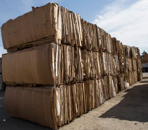 Large bundles of cardboard ready for recycling.
