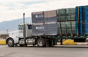 18-wheeler truck loaded with packaging supples driving off.