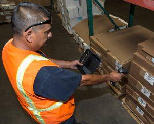 Worker scanning boxes.